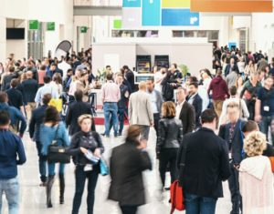 Stylized image of a crowded trade show