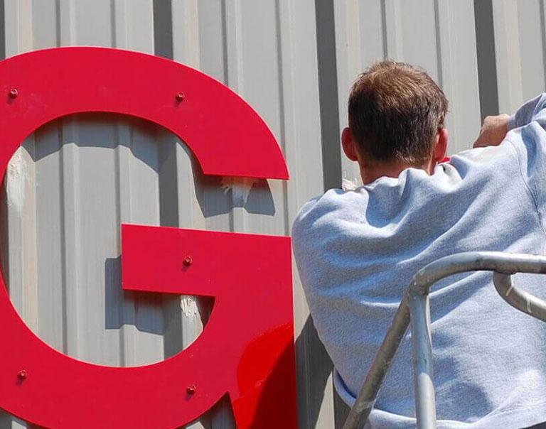 Man installing an outdoor sign